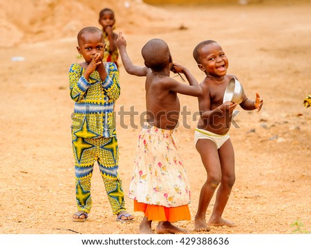 PORTO-NOVO, BENIN - MAR 10, 2012: Unidentified Beninese childrel play in the street. People of Benin suffer of poverty due to the difficult economic situation