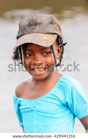 PORTO-NOVO, BENIN - MAR 9, 2012: Unidentified Beninese lovely girl in a nice hat. People of Benin suffer of poverty due to the difficult economic situation.