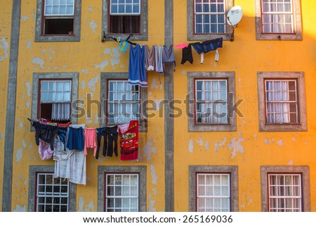 PORTO, PORTUGAL - CIRCA FEB, 2015: Traditional drying clothes in Old Town of Porto. In 1996, UNESCO recognised Old Town of Porto as a World Heritage Site.
