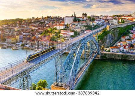 Porto, Portugal cityscape on the Douro River and Dom Luis I Bridge. - stock photo
