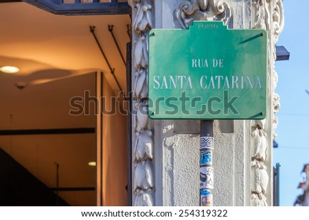 Porto, Portugal. December 29, 2014: A street sign showing Rua de Santa Catarina, the name of the most commercial street of the city of Porto, where large brands locate their stores. - stock photo