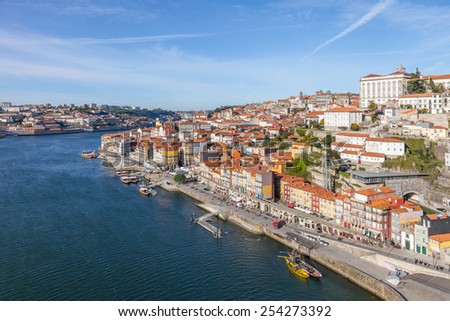 Porto, Portugal. December 29, 2014: The typical colorful buildings of the Ribeira District and the Douro River in the city of Porto, Portugal. Unesco World Heritage. - stock photo
