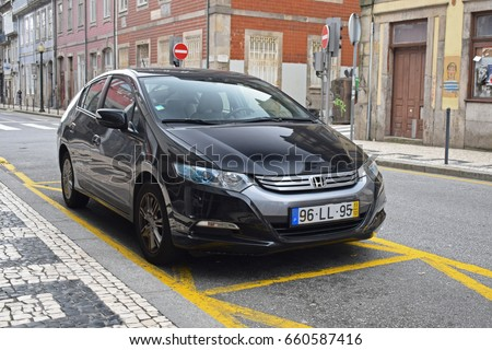 Porto, Portugal - February, 26, 2017: Honda Insight hybrid car parking on the street.
