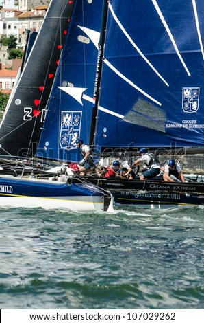 PORTO, PORTUGAL - JULY 07: Groupe Edmond de Rothschild compete in the Extreme Sailing Series boat race on july 07, 2012 in Porto, Portugal.
