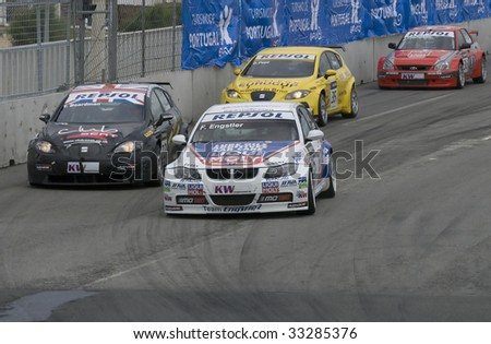 PORTO, PORTUGAL - JULY 5: KRISTIAN POULSEN of DIN in his BMW team Liqui Moly Team participates in the FIA WORLD TOURING CAR CHAMPIONSHIP on July 5, 2009 in Porto, Portugal. - stock photo