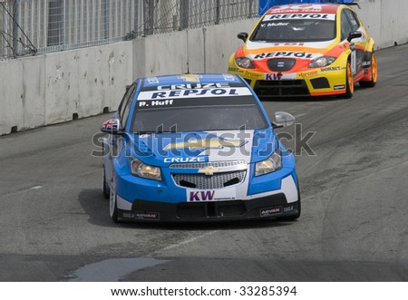 PORTO, PORTUGAL - JULY 5: ROBERT HULF of UK in his Chevrolet Cruze LT participates in the FIA WORLD TOURING CAR CHAMPIONSHIP on July 5, 2009 in Porto, Portugal - stock photo