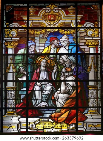 Porto, Portugal - March 23, 2015: Stained glass window from  church of Lapa representing a biblical scene from the New Testament, young Jesus among scholars - stock photo