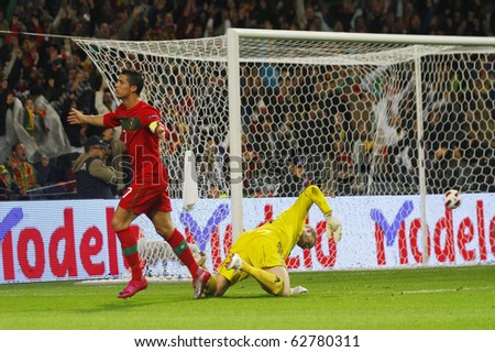 PORTO, PORTUGAL - OCTOBER 08: Cristiano Ronaldo (POR) celebrates after scoring Portugal's 3rd goal as Denmark's Goalkeeper despairs in Euro 2012 Qualifying match on October 8, 2010 in Porto, Portugal - stock photo