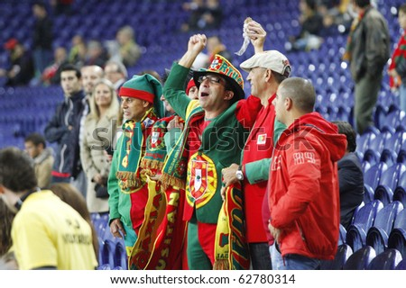 PORTO, PORTUGAL - OCTOBER 8: Portuguese supporters enjoying  the Euro 2012 Group Stage Qualifying match against Denmark on October 8, 2010 in Porto, Portugal - stock photo