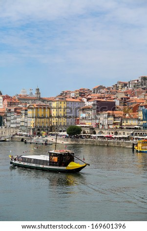 PORTO, PORTUGAL - SEPTEMBER 5: Tourist boat on Douro river in Porto, Portugal at September 5, 2013. Historic Centre of Porto is a UNESCO World Heritage Site since 1996.
