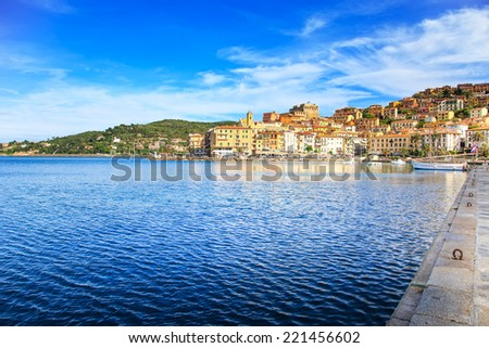 Porto Santo Stefano harbor seafront and village skyline, italian travel destination. Monte Argentario, Tuscany, Italy. - stock photo
