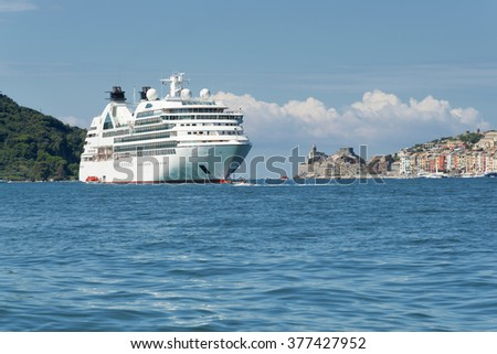 Porto Venere in the gulf of poets, with docked cruise ship - stock photo