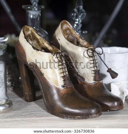 Portobello Road Market . London. Wooden shoes. Selective focus - stock photo