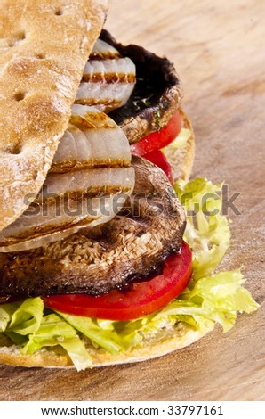 Portobello sandwich with grilled onion lettuce and tomato