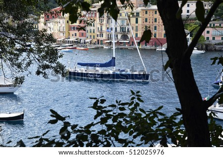 Portofino, Italy - October 11, 2016: Tourist boats moored in the harbor in autumn