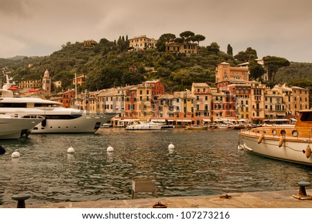 Portofino - Italy : warm light in the bay on a cloudy day - stock photo