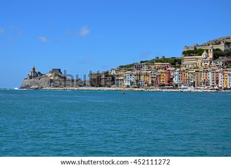 PORTOVENERE, ITALY - JUNE 17 2016: Portovenere is located on the Ligurian coast and it is famous for its colorful buildings at the seaside and Church of Saint Peter.