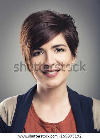 Portrairt of a beautiful woman with a modern hair cut - stock photo