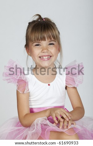 Portrait a a cheerful ballerina laughing, studio image - stock photo