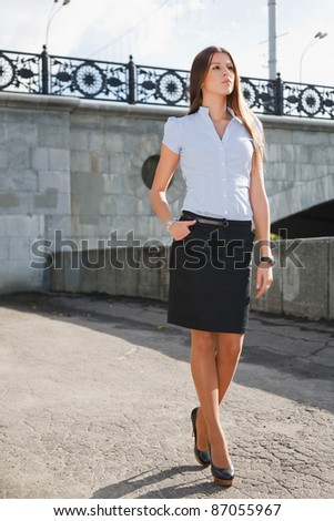 Portrait a beautiful caucasian woman walking at the street - stock photo