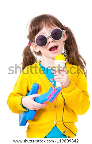 Portrait a little pretty girl dressing up as famous singer - stock photo