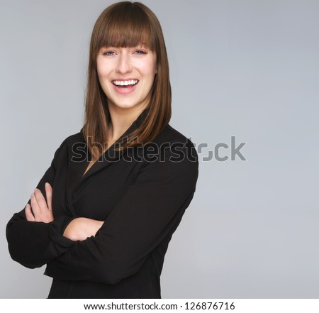 Portrait a professional business woman smiling - stock photo