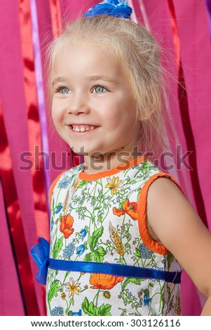 Portrait Adorable little girl laying on pink  background  - stock photo