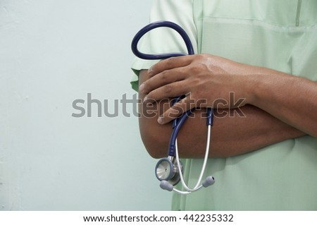 Portrait an unknown  nurse holding a stethoscope - stock photo