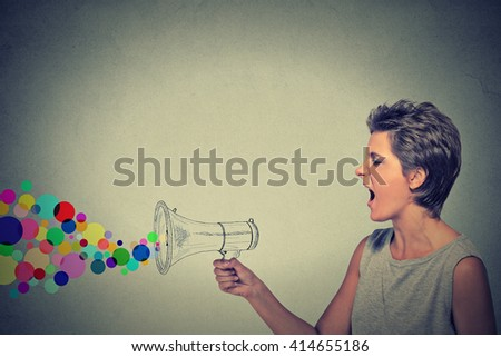 Portrait angry screaming young woman with megaphone isolated on grey wall background. Negative face expression emotion feelings. Propaganda, breaking news, power, social media communication concept - stock photo