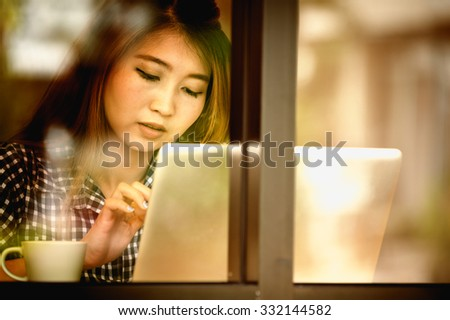 Portrait asia young woman working on laptop in coffee shop, Vacations concept. - stock photo