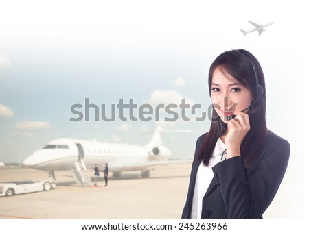 portrait asian businesswomen or call center has background of airport.Mixed Asian / Caucasian businesswoman.Positive emotion - stock photo