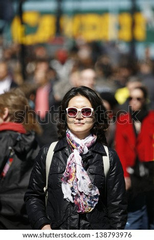Portrait asian woman in the middle of a crowd of Camden Street - stock photo