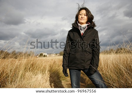Portrait asian woman looking at camera in the field