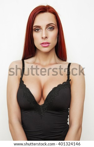 portrait attractive girl with red hair and sexy big breasts - stock photo