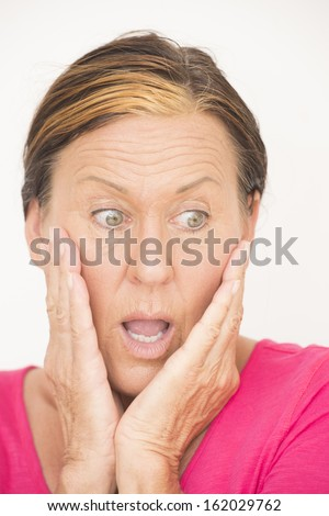 Portrait attractive mature woman with shocked and surprised, anxious and concerned facial expression, isolated on white. - stock photo