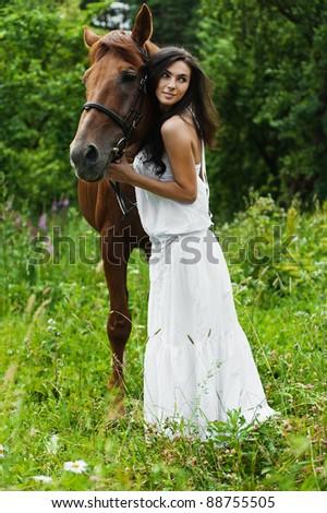 portrait attractive woman full length next horse - stock photo