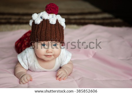 portrait , baby hat, close-up portrait , baby photos - stock photo