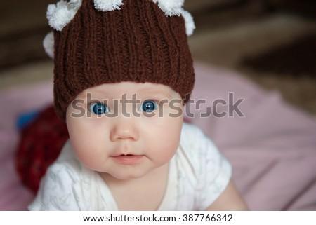 portrait , baby hat, close-up portrait , baby photos - stock photo
