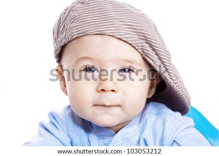 portrait baby with a hat in studio - stock photo