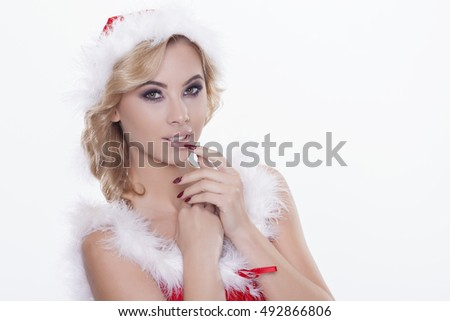Portrait beautiful and sexy woman wearing santa clause cap isolated on white background