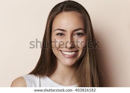 Portrait beautiful brunette model, smiling - stock photo