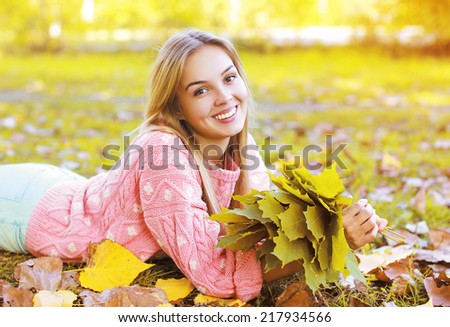 Portrait beautiful charming smiling girl in autumn season - stock photo