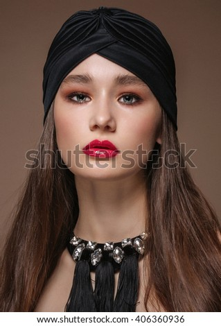 Portrait Beautiful fashion east woman. Indian arabic girl with black turban.  - stock photo