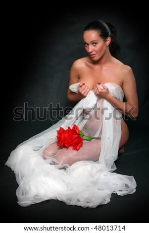 Portrait beautiful girl dressed in bridal veil with flower. - stock photo