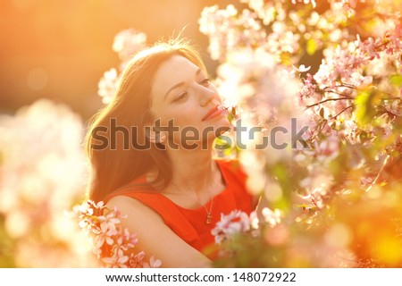 portrait beautiful girl on background blooming tree - stock photo