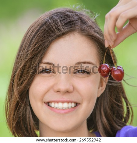 portrait beautiful girl with black cherry - stock photo