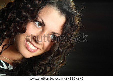 portrait beautiful girl with curly hair in studio shooting .  beautiful makeup, bright emotions