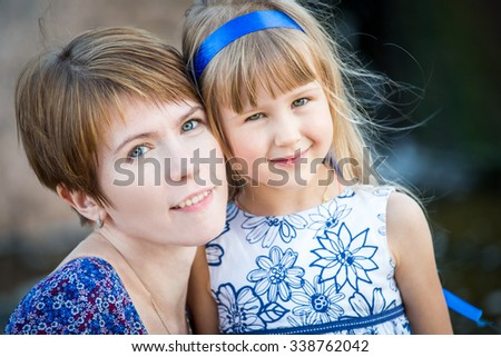 Portrait beautiful mom and daughter - stock photo