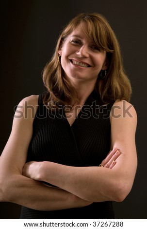 portrait, beautiful smiling woman with arms crossed