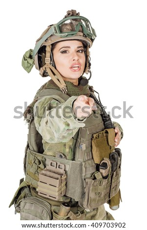 Portrait beautiful soldier or private military contractor pointing her finger at you . war, army, weapon, technology and people concept. Image on a white background. - stock photo